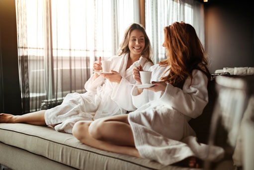 Two women relaxing in Robes at the spa